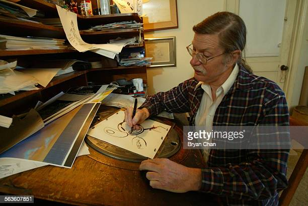 Animator Mark Kausler works on a sketch for his short animation 'It's the Cat' He is working on an old animation in–betweener desk from Disney...