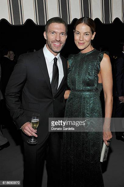 Animator Travis Knight and actress Michelle Monaghan wearing Burberry attend the Vanity Fair and Burberry event celebrating Felicity Jones and the...