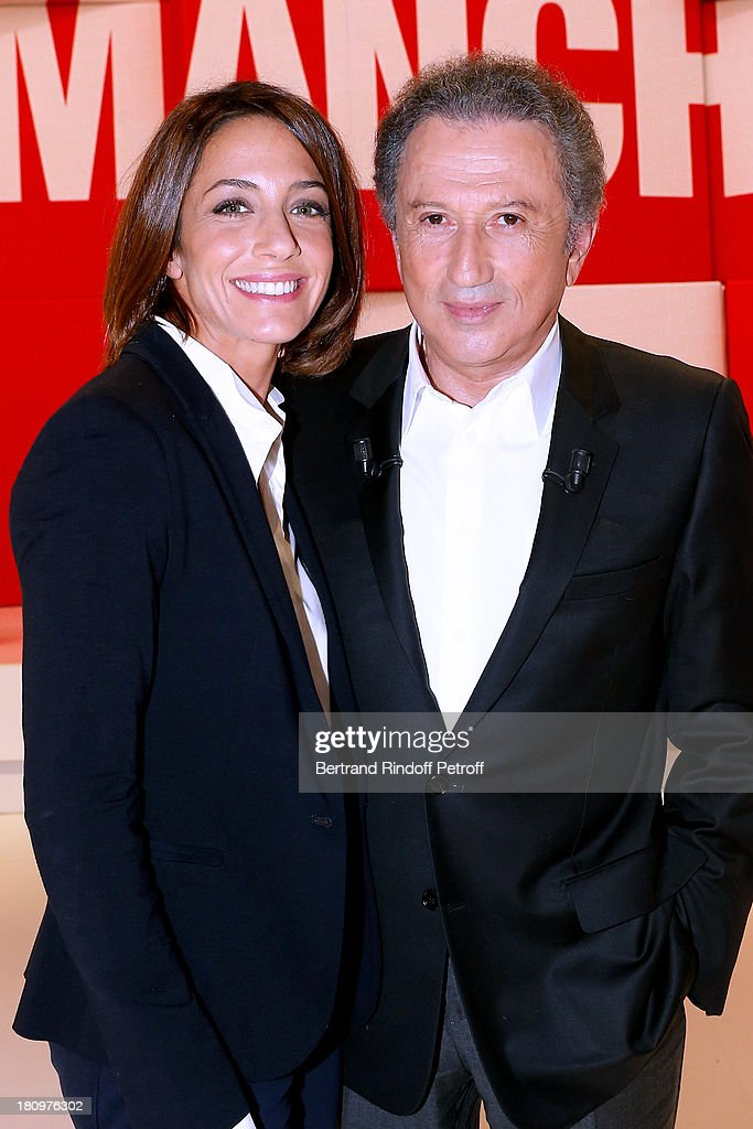 TV animator virginie guillaume and presenter of the show Michel Drucker attend 'Vivement Dimanche' French TV Show at Pavillon Gabriel on September 18, 2013 in Paris, France.