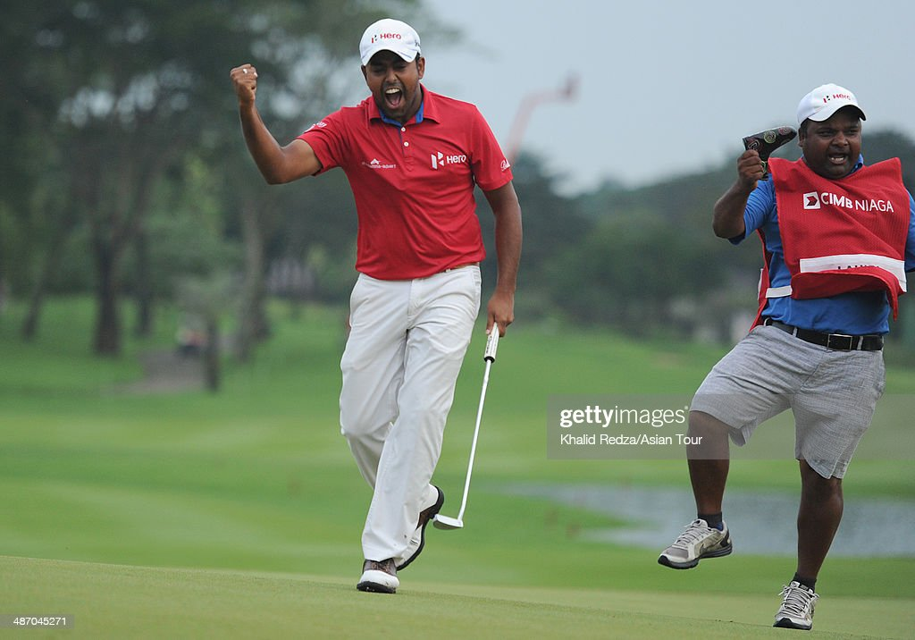 Anirban Lahiri Lahiri of India in screams in delight with his caddie, Rajiv Sharma after winning his first title outside India of the CIMB Niaga Indonesian Masters at Royale Jakarta Golf Club on April 27, 2014 in Jakarta, Indonesia.