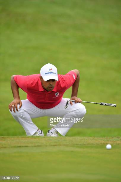Anirban Lahiri of Asia lines up a putt during the fourballs matches on day one of the 2018 EurAsia Cup presented by DRBHICOM at Glenmarie GCC on...