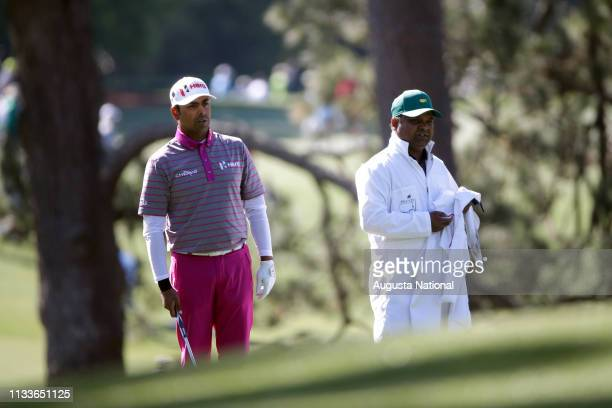 Anirban Lahiri of India and his caddie Rajiv Sharma look down No 1 during Round 2 at Augusta National Golf Club on Friday April 8 2016