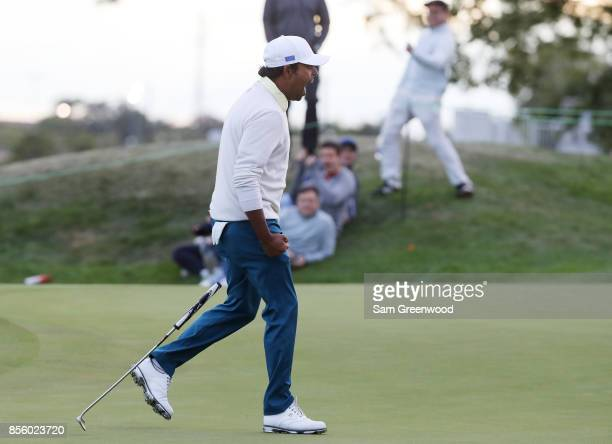 Anirban Lahiri of India and the International Team celebrates on the 17th green during Saturday fourball matches of the Presidents Cup at Liberty...