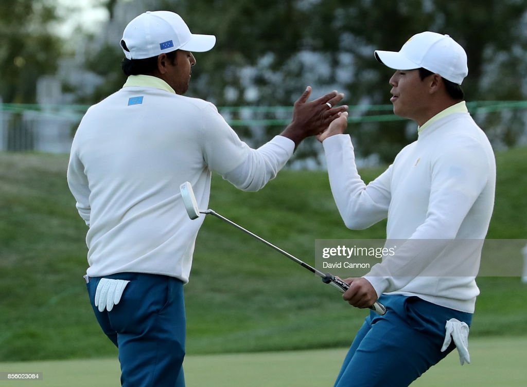 Anirban Lahiri of India and the International team is congratulated by his partner Si Woo Kim of South Korea after Lahiri had holed a crucial birdie putt on the 17th hole in their match against Charley Hoffman and Kevin Chappell of the United States during the Saturday afternoon fourball matches in the 2017 Presidents Cup at the Liberty National Golf Club on September 30, 2017 in Jersey City, New Jersey.
