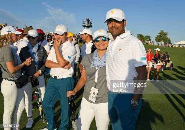 Anirban Lahiri of India and the International Team poses with his wife Ipsa Lahiri during the first round of the Presidents Cup at Liberty National...