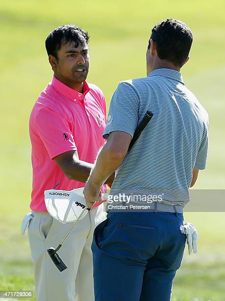 Anirban Lahiri of India congratulates Justin Rose after Rose won on the 19th hole during round two of the World Golf Championship Cadillac Match Play...