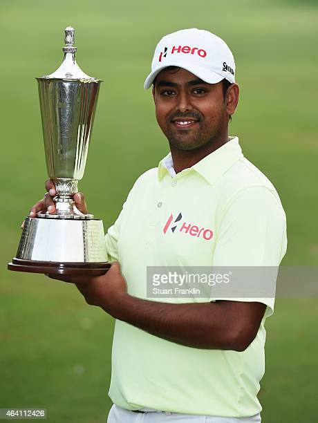 Anirban Lahiri of India holds the trophy after winning the Hero India Open Golf at Delhi Golf Club on February 22 2015 in New Delhi India