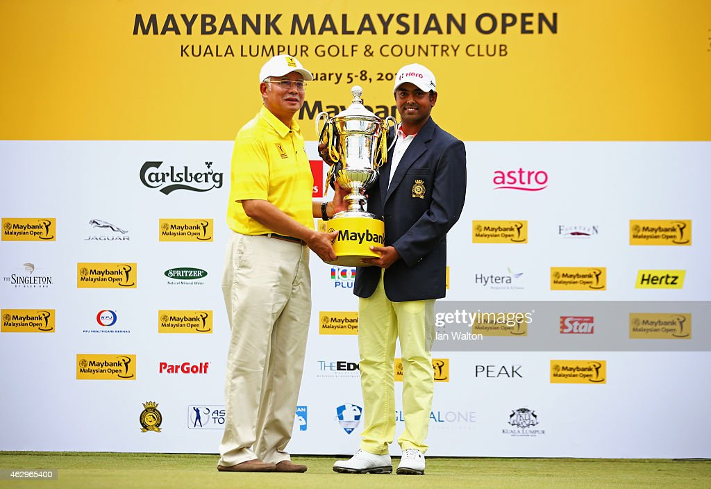 Anirban Lahiri of India is presented with the trophy by Prime Minister of Malaysia Abdul Razak after victory during the final round of the Maybank Malaysian Open at Kuala Lumpur Golf & Country Club on February 8, 2015 in Kuala Lumpur, Malaysia.