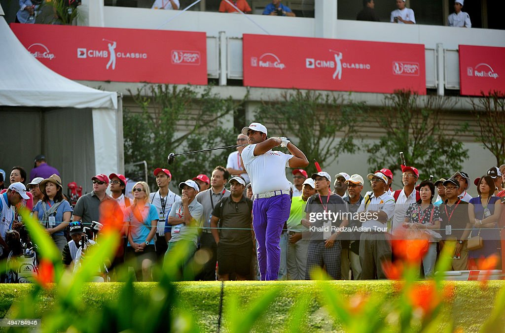 Anirban Lahiri of India plays a shot during round one of the CIMB Classic at Kuala Lumpur Golf & Country Club on October 29, 2015 in Kuala Lumpur, Malaysia.