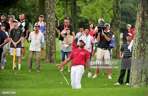 Anirban Lahiri of India plays a shot during round two of the CIMB Classic at Kuala Lumpur Golf & Country Club on October 30, 2015 in Kuala Lumpur,...