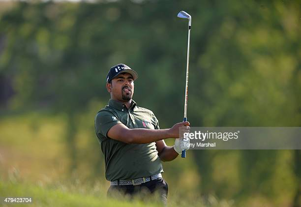Anirban Lahiri of India plays his second shot on the 1st fairway during the Alstom Open de France Day Three at Le Golf National on July 4 2015 in...