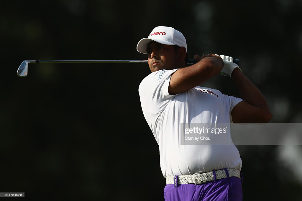 Anirban Lahiri of India plays his shot on the 11th hole during round one of the CIMB Classic at Kuala Lumpur Golf & Country Club on October 29, 2015 in Kuala Lumpur, Malaysia.