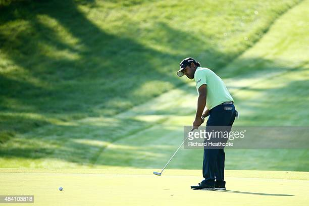 Anirban Lahiri of India putts on the ninth green during the continuation of the weather-delayed second round of the 2015 PGA Championship at...