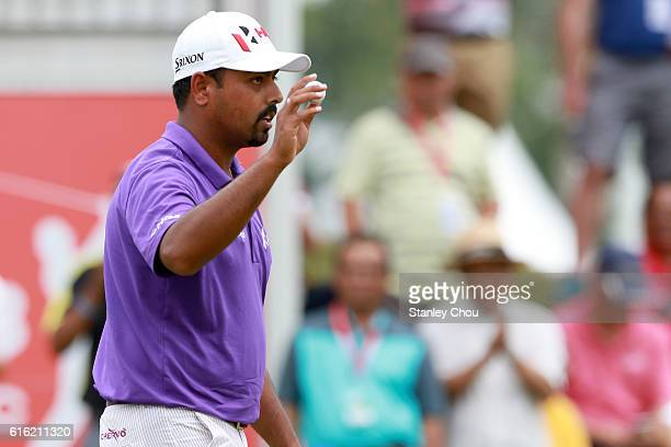 Anirban Lahiri of India reacts after sinking a birdie on the 18th hole during day three of the 2016 CIMB Classic at Kuala Lumpur Golf Country Club on...