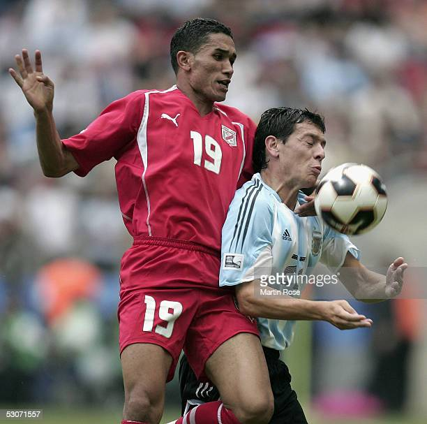Anis Ayari of Tunisia challenges Luciano Galletti of Argentina during the FIFA Confederations Cup Match between Argentina and Tunisia on June 15 2005...