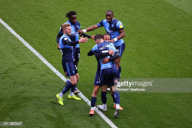 Anis Mehmeti of Wycombe Wanderers celebrates with teammates after scoring their team's first goal during the Sky Bet Championship match between...