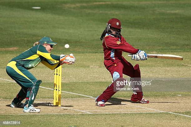 Anisa Mohammed of the West Indies bats in front of Alyssa Healy of Australia during game two of the International Women's Twenty20 series between...