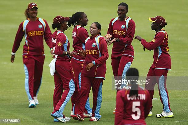 Anisa Mohammed of the West Indies celebrates with her team after taking a wicket during game one of the women's One Day International series between...