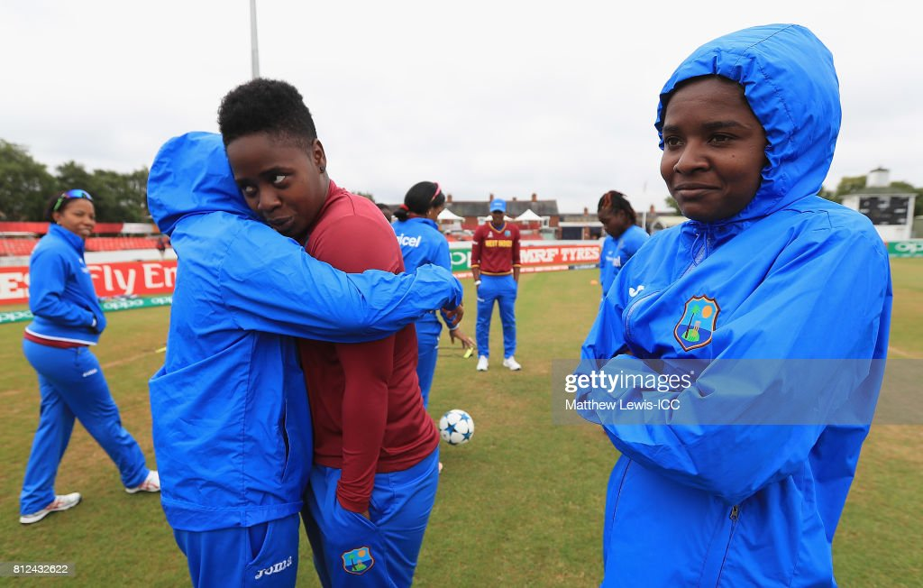 Anisa Mohammed of the West Indies hugs Shanel Daley, as Felicia Walters looks on during the ICC Women's World Cup 2017 match between West Indies and Pakistan at Grace Road on July 11, 2017 in Leicester, England.
