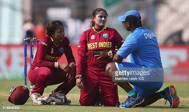 Anisa Mohammed of the West Indies receives treatment during the Women's ICC World Twenty20 India 2016 Final between Australia and West Indies at Eden...
