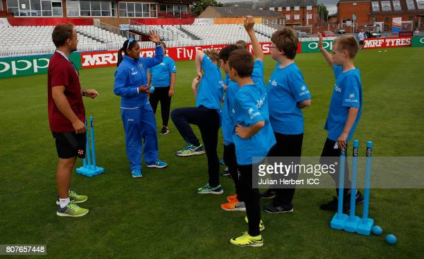 Anisa Mohammed of The West Indies takes works with local school children during an ICC Cricket for Good clinic at The County Ground on July 4 2017 in...