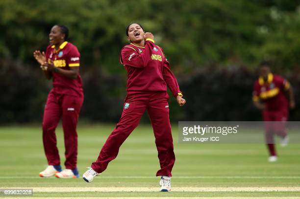 Anisa Mohammed of West Indies celebrates the wicket of Chloe Tryon of South Africa during the ICC Women's World Cup warm up match between West Indies...