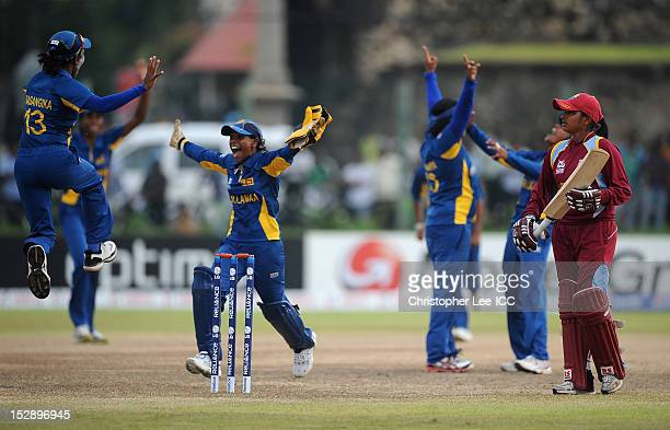 Anisa Mohammed of West Indies looks dejected as Deepika Rasangika and Dilani Manodara of Sri Lanka celebrate their victory during the ICC Women's...