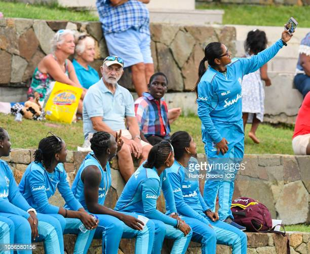 Anisa Mohammed of West Indies takes a selfie with the team during an unofficial warmup match between India and South Africa at Sir Vivian Richards...