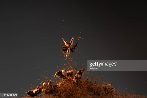 """anise dancing in mid air with black background captured in high speed""""n - スターアニス ストックフォトと画像"""