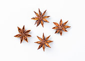 Anise star  on white background. Aniseed. True star anise close up. Badiane. Spices.
