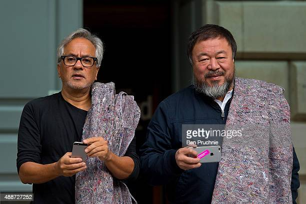 Anish Kapoor and Ai Weiwei pose for members of the press at the Royal Academy ahead of their walk through the city as part of a march in solidarity...