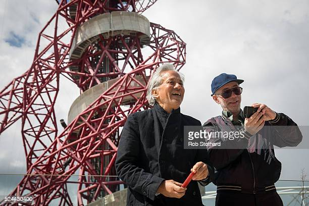 Anish Kapoor and Carsten Holler pose for photographers in front of the ArcelorMittal Orbit tower at the Queen Elizabeth Olympic Park on April 26 2016...