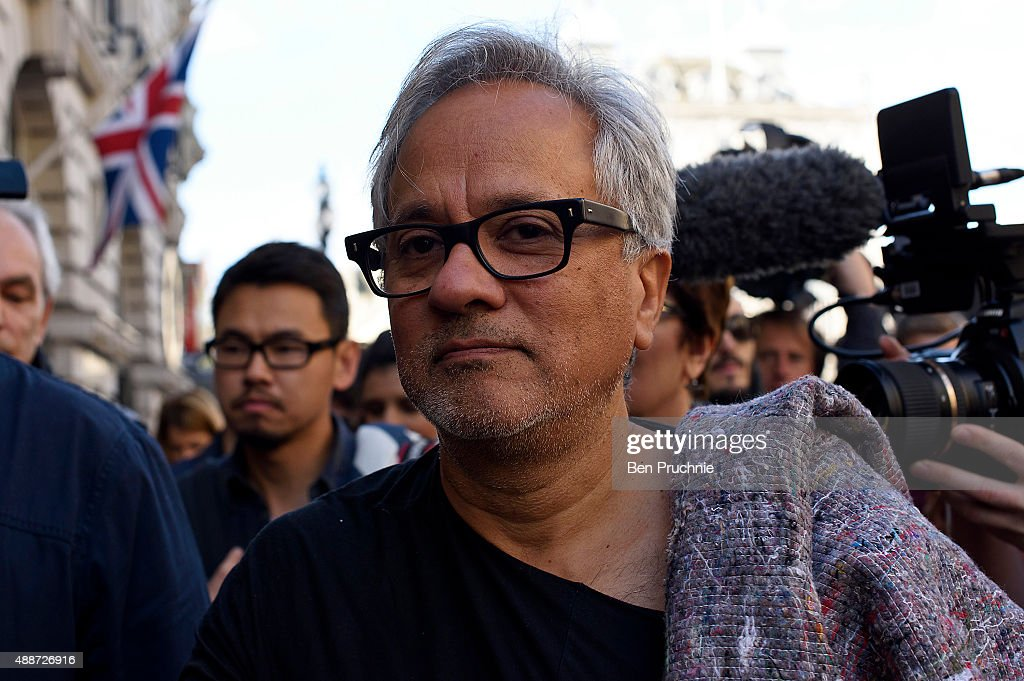 Anish Kapoor walks through the city as part of a march in solidarity with migrants currently crossing Europe on September 17, 2015 in London, England. Each artist carried a single blanket symbolizing the needs that face migrants coming to Europe.