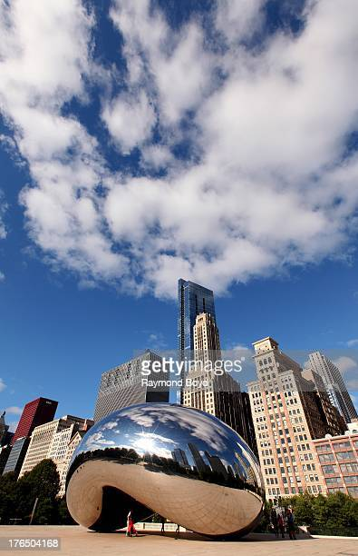 Anish Kapoor's 'Cloud Gate' with buildings from the Michigan Avenue skyline in view in Chicago Illinois on JULY 24 2013