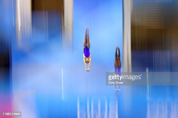 Anisley Garcia Navarro and Arlenys Garcia Gomez of Cuba compete in the women's synchronized diving 10M Final at the Aquatics Center of Villa...