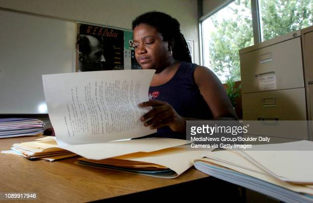 Anissa Butler , Humanities teacher, check her hand out papers for errors Wednesday afternoon at New Vista High School. Classes start Thursday morning.