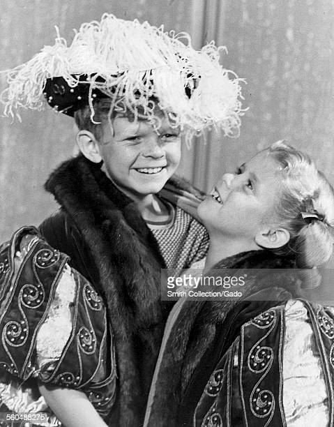 Anissa Jones and Johnny Whitaker during filming of the television show 'Family Affair' wearing royal outfits and smiling March 28 1969
