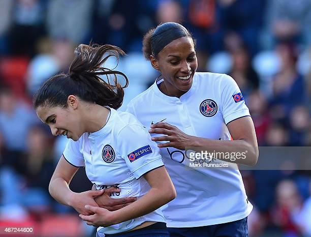 Anissa Lahmari of Paris SaintGermain celebrates with team mate MarieLaurie Delie after scoring the opening goal of the game during the UEFA Woman's...