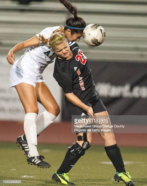 Anissa Raja, left, of Aliso Niguel goes over the shoulder of Audrey Kate Ward of San Clemente in a South Coast League girls soccer game at Aliso...