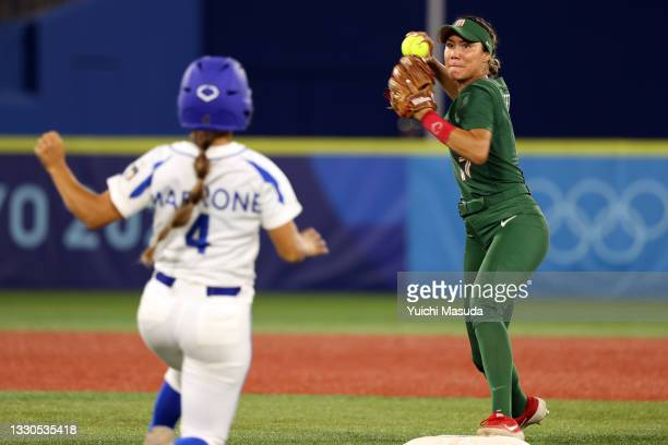 Anissa Urtez of Team Mexico throws to first base in the sixth inning against Team Italy during the Softball Opening Round on day two of the Tokyo...