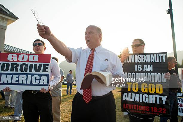 Anit same sex marriage protestors yell out during a protest in front of the Rowan County Courthouse September 4 2015 in Morehead Kentucky Kim Davis...