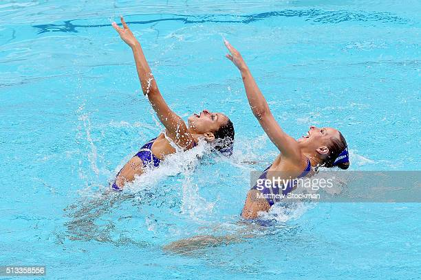 Anita Alvarez and Mariya Koroleva of the United States compete in the Duets Technical Routine First Round during the FINA Olympic Games Synchronised...