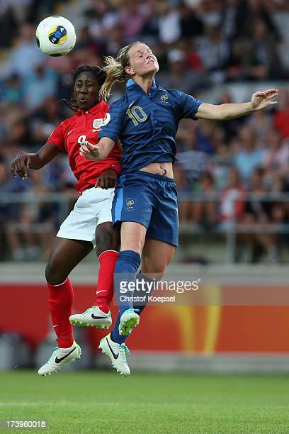 Anita Asante of England and Amandine Henry of France go up for a header during the UEFA Women's EURO 2013 Group C match between France and England at...
