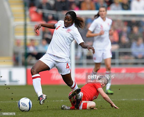 Anita Asante of England is challenged by Diana Matheson of Canada during the Women's International Match between England Women and Canada Women at...