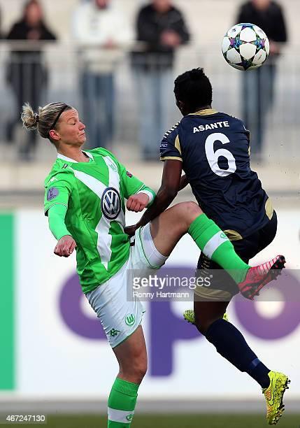 Anita Asante of Rosengard of Rosengard and Alexandra Popp of Wolfsburg compete during the first UEFA Women's Champions League quarter final match...