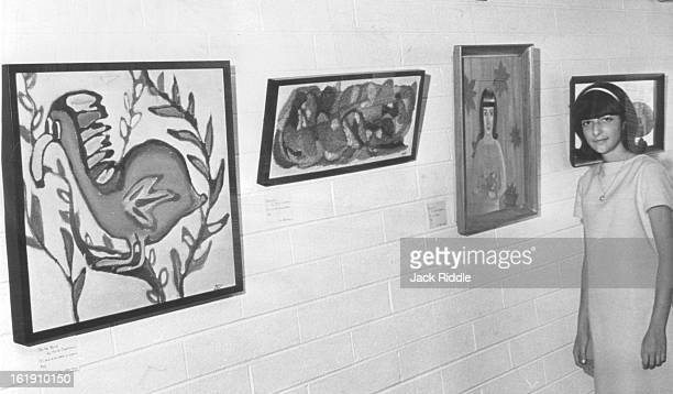 JUL 28 1967 JUL 29 1967 AUG 2 1967 Anita Clearfield Stands Near Wall With Three of Her Oil Paintings The paintings just a few of the show are of a...