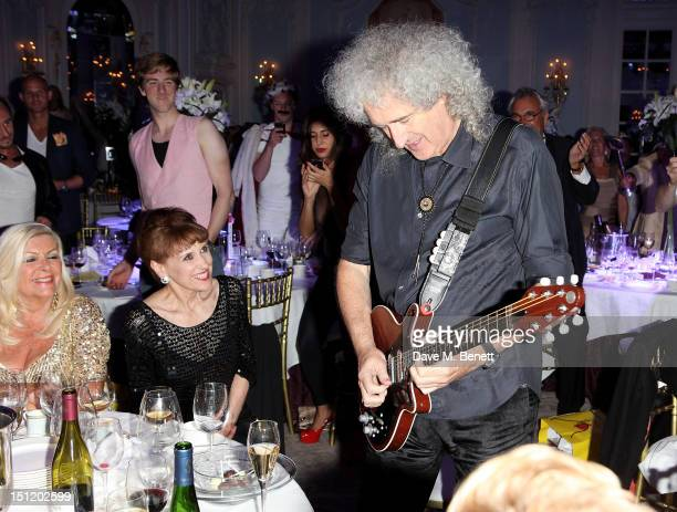 Anita Dobson and Brian May attend the second annual 'Freddie For A Day' event in memory of Queen's late frontman Freddie Mercury at The Savoy Hotel...
