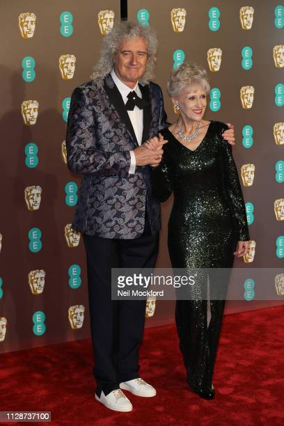 Anita Dobson and Brian May attends the EE British Academy Film Awards at Royal Albert Hall on February 10 2019 in London England