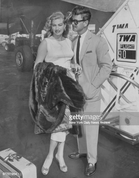 Anita Ekberg and her husband Anthony Steele arriving at Idlewild Airport from Hollywood via TWA's Hollywood Special Ekberg is filming the movie 'Back...