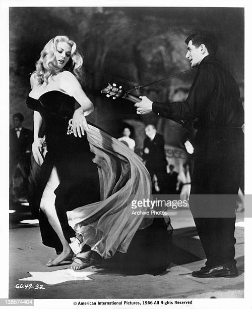 Anita Ekberg dancing to guitarist in a scene from the film 'La Dolce Vita' 1960